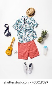 collection collage of men's clothing and accessories. Overhead of essentials young man on vacation. Summer outfit of casual man, camera, sunglasses.