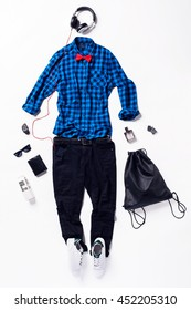 collection collage of men's clothing and accessories. Overhead of essentials young elegant man. Outfit of casual man, shoes, smart phone, headphones, sunglasses, red bow.