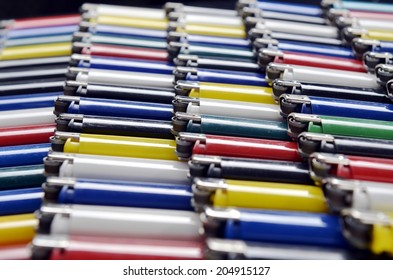 collection of colored plastic disposable lighters for smokers