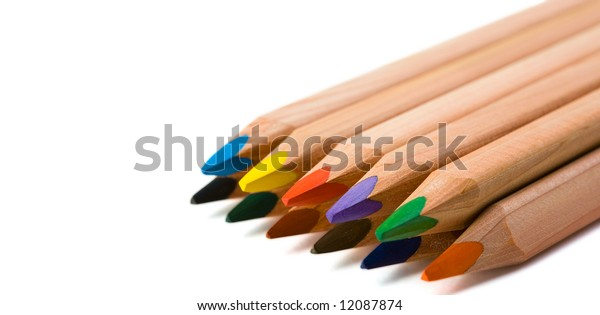 collection of colored three-cornered pencils isolated on white with clipping path