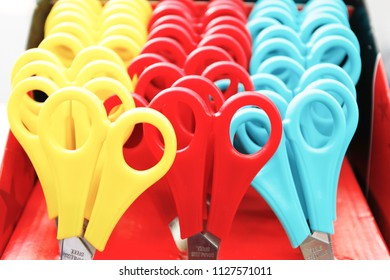 A collection of colorful children's scissors in a school