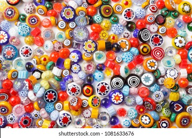 Collection of colorful glass beads. Colored Venetian, Murano glass, millefiori. Isolated on white background. Flat lay, top view