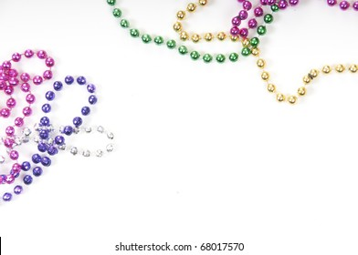 collection of colorful mardi gras beads