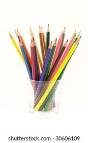collection of colorful pencils in glass isolated on white background