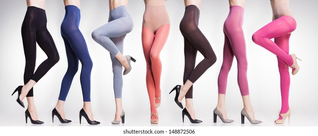 collection of colorful tights and stockings on sexy woman legs isolated on grey