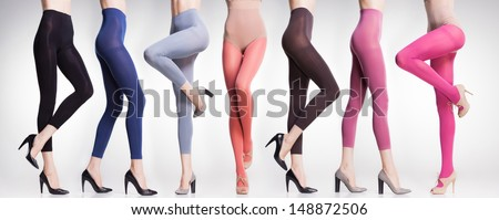 30567bebd58 collection of colorful tights and stockings on sexy woman legs isolated on  grey