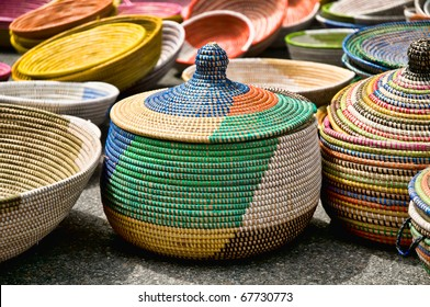 A collection of colorful woven baskets.