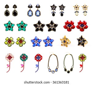 collection of crystal jewelry, earrings, rings, necklaces and brooches isolated on white background