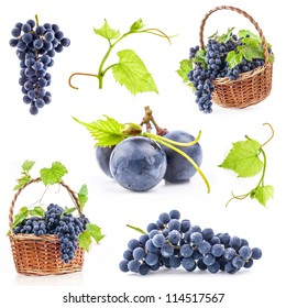 Collection of Dark grapes with leaves in a wicker basket, Isolated on white background