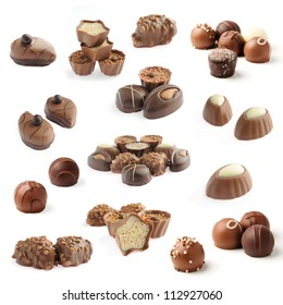 collection of delicious chocolate pralines isolated on white background
