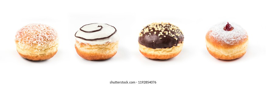 Collection of delicious doughnuts side by side isolated on white background, view from side