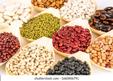 The collection of different beans in the bamboo bowls.