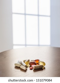 Collection of different colors and sizes of vitamins and supplements taken with breakfast for healthy lifestyle