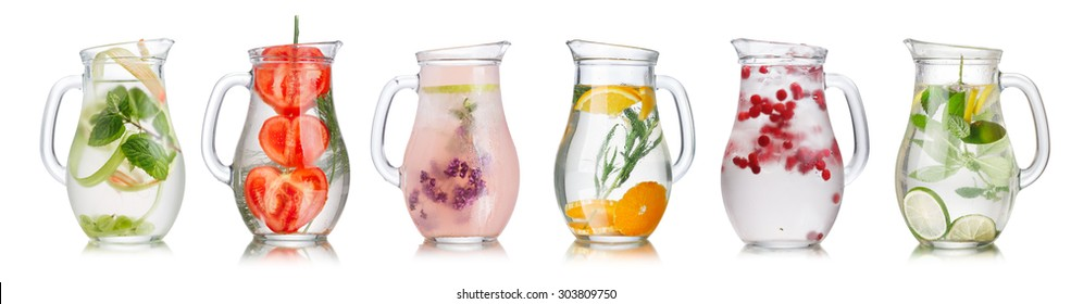 Collection of different detox water (infused water) in a glass pitchers.