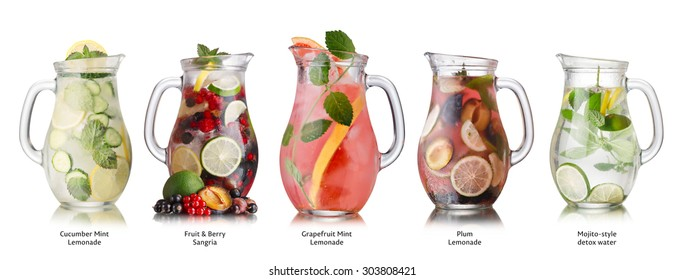 Collection of different drinks in glass pitchers. Glasses full of spritzers,lemonade,iced tea, detox waters. Healthy eating