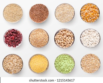 Collection of different groats isolated on white background. Top view of cereals, rice, legumes, beans and lentils in bowls.