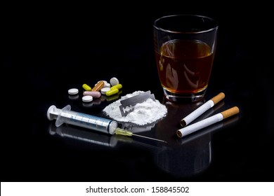 Collection of different hard drugs Heroin, Pills, Tobacco and Alcohol