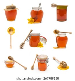 collection of different honey jars and honey dippers on white background