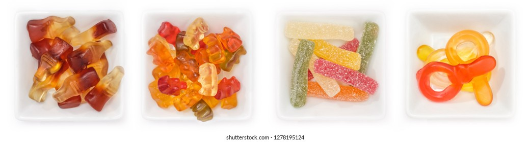 Collection of different sweets with fruit gum in bowls in top view