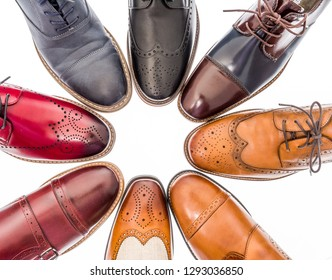 A collection of dress shoes of different colors and kind on an isolated background