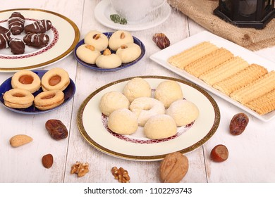 Collection of Eid El Fitr kahk and biscuits - Pouring sugar over the cookies of El Fitr Islamic Feast