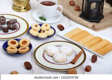 Collection of Eid El Fitr kahk and biscuits - Cookies of El Fitr Islamic Feast with Arabian lantern and cup of tea