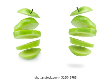Collection of floating sliced green apple isolated on a white background.
