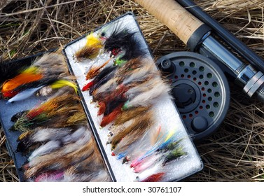 A collection of fly fishing flies and fly fishing rod