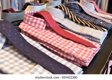 Collection of folded men shirts with ties
