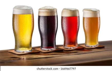 Collection of four types of different beer in glasses isolated on a white background. File contains a clipping path.