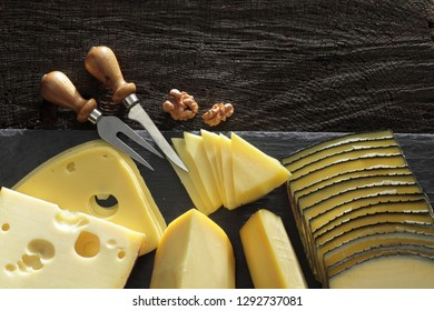 Collection of French, Italian, Holland and Swisss hard cheeses on the cheese board