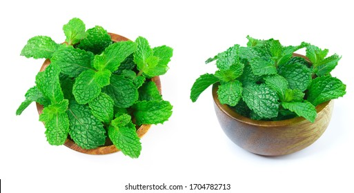 Collection of fresh raw mint leaves in wooden bowls isolated on white background.