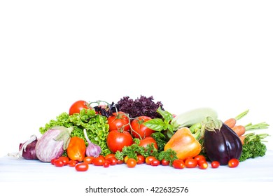 Collection of fresh vegetables on white background.