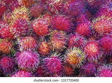 A collection of the fruit Rambutans on display in a market