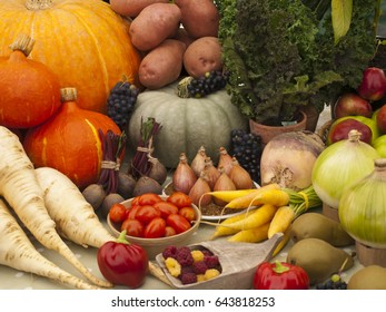 A Collection of Fruit and Vegetables. Healthy Foods. Pepper, Pumpkin, Potatoes, Parsnips, Carrots, Onions, Pears, Beetroot, Apples, Shallots, Lettuce, Tomatoes, Grapes and Raspberries