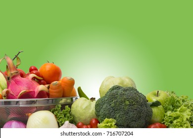 Collection fruits and vegetables in the basket  table isolated on a green background.