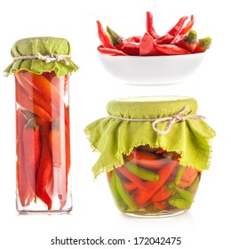 Collection of Glass jars of preserved red pepper isolated on white background