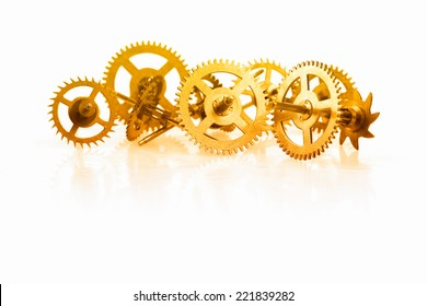 a collection of golden clock gear on a white background