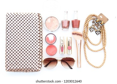 Collection of golden color accessories and makeup woman beauty fashion set on white background