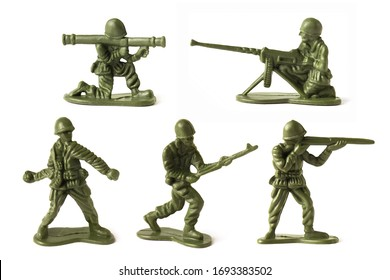 Collection of green toy plastic soldiers, isolated on white background