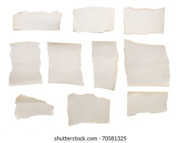 collection of grey ripped pieces of paper on white background. each one is shot separately