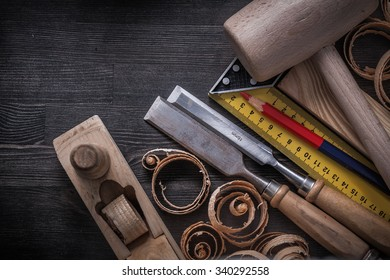 Collection of joiner tools on wood board construction concept.