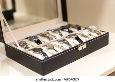 Collection of  ladies wrist watches in storage box