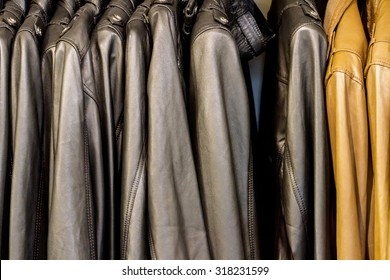 Collection of leather jackets on hangers in the shop