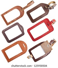 Collection of leather luggage tags isolated on white background