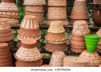 A collection of locally made flower pots being sold on the side of the road in a local village in Africa.