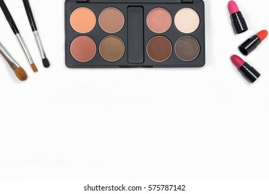 Collection of makeup cosmetics palette, lipstick and brushes on white background with copy space, Flat lay top view