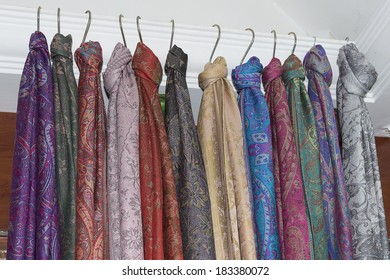 collection of many colorful Pashmina scarves