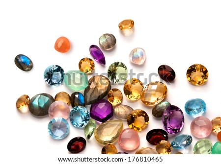 Collection of many different natural gemstones on the white background: amethyst, lapis lazuli, rose quartz, citrine, ruby, amazonite, moonstone, labradorite, chalcedony, blue topaz and many more.