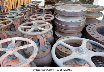 A collection of massive ship valves with large handwheels